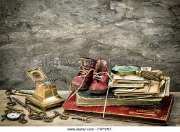 Antique Books And Photos Writing Accessories Old Baby Shoes Vintage Style Toned Picture