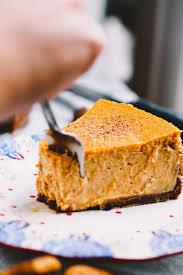 Pumpkin Gingersnap Cheesecake Bars by Pumpkin Cheesecake With Gingersnap Crust Plays Well With Butter