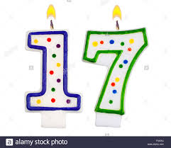 Birthday candles number seventeen isolated on white background