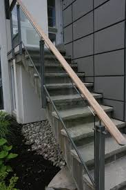 Glass Railings Exterior | Exterior Wooden Cap Glass Railing ... Modern Glass Stair Railing Design Interior Waplag Still In Process Frameless Staircase Balustrade Design To Lishaft Stainless Amazing Staircase Without Handrails Also White Tufted 33 Best Stairs Images On Pinterest And Unique Banister Railings Home By Larizza Popular Single Steel Handrail With Smart Best 25 Stair Railing Ideas Stairs 47 Ideas Staircases Wood Railings Rustic Acero Designed Villa In Madrid I N T E R O S P A C
