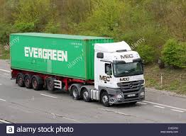 An MEC Truck Hauling An Evergreen Shipping Container Along The M20 ... Select Legal Boat Hauling Company For Shipping Putting The Big Ones On Bus Feed Yard Foodie Container Transit Truck Psd Mockup Mockups Side Loader Delivery Of 20ft Youtube Ship A Car From Usa To Africa Get Rates Overseas Relocations Sea Containers Nz Tangerine Mandarin Demand And Fuel Plus An Mec Truck Hauling An Evergreen Shipping Container Along M20 Sunnyfield Veg Ltd Whats Best Way The Autotempest Blog