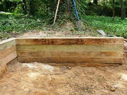 Building A Timber Retaining Wall | How-tos | DIY Brick Garden Wall Designs Short Retaing Ideas Landscape For Download Backyard Design Do You Need A Building Timber Howtos Diy Question About Relandscaping My Backyard Building Retaing Fire Pit On Hillside With Walls Above And Below 25 Trending Rock Wall Ideas Pinterest Natural Cheap Landscaping A Modular Block Rhapes Sloping Also Back Palm Trees Grow Easily In Out Sunny Tiered Projects Yard Landscaping Sloped