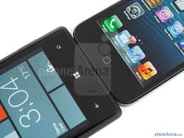 The HTC Windows Phone 8X left and the Apple iPhone 5 right