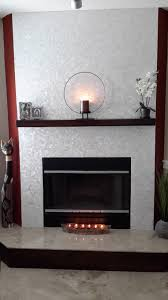 white groutless square of pearl tile fireplace surround