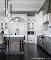 White And Gray Kitchen Features Upper Cabinets Lower Paired With Honed Marble Countertops A Slab Backsplash