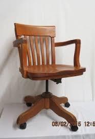 Oak desk chair art deco Swivel tilting rolling office chair via