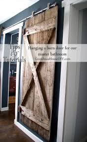 We Finally Got Our Hanging Barn Door Up! - Grandmas House DIY White Sliding Barn Door Track John Robinson House Decor How To Epbot Make Your Own For Cheap Knotty Alder Double Sliding Barn Doors Doors The Home Popsugar Diy Youtube Rafterhouse Porter Wood Inside Ideas Best 25 Interior Ideas On Pinterest Reclaimed Gets Things Rolling In Bathroom Http Beauties American Hardwood Information Center Design System Designs Tutorial H20bungalow