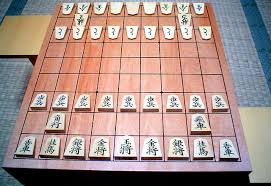 A Traditional Shogi Ban Board Displaying Set Of Koma Pieces The On Far Side Are Turned To Show Their Promoted Values