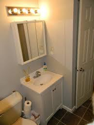 bathroom lighting above medicineabinet modest on pertaining