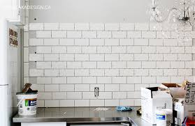 subway tile wall kitchen