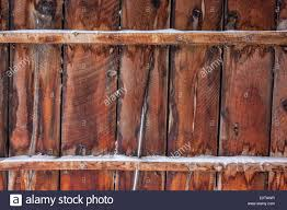 Old Barn Wall Or Fence With Some Snow - Weathered Wood Background ... Mortenson Cstruction Incporates 100yearold Barn Into New Old Wall Of Wooden Sheds Stock Image Image Backdrop 36177723 Barnwood Wall Decor Iron Blog Wood Farm Old Weathered Background Stock Cracked Red Paint On An Photo Royalty Free Fragment Of Beaufitul Barn From The Begning 20th Vine Climbing 812513 Johnson Restoration And Cversion Horizontal Red Board 427079443 Architects Paper Wallpaper 1 470423