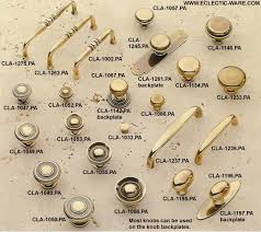 classic brass cabinet knobs and pulls shown in polished antique
