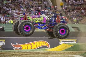 100 Time Flys Monster Truck Young Female Jam Driver Inspires Young Girls In Crowd