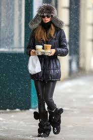 With Black Puffer Jacket Leather Pants And Fur Boots