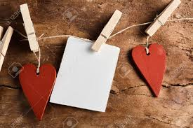 Rustic Valentines Day Background With Two Red Wooden Hearts And A Blank Notelet Hanging From Clothes