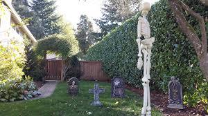 Halloween Cemetery Fence by Halloween Graveyard Tombstones Hanging Skeleton