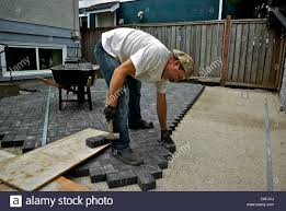 Stonemason Laying Patio Construction Bricks Sand Gravel Base ... Exterior Design Beautiful Backyard Landscaping Ideas Plan For Lawn Garden Pleasant Japanese Rock Go With Gravel For A You Never Have To Mow Small Stupendous Modern Gardens Garden Design Coloured Path Easy Backyards Winsome Decorative Design Gardening U The Beautiful Pathwaysnov2016 Gold Exteriors Magnificent Patio With Rocks And Stones