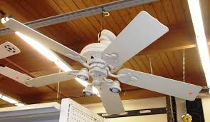 interior white kitchen ceiling fan on brown wooden ceiling