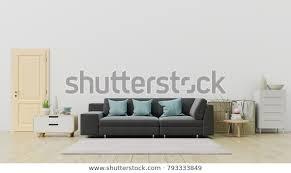 wohnzimmer mit schwarzem sofa und dekoration mit weißer