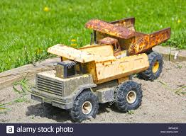 Old Worn And Rustic Dump Truck Toys In A Sandbox Stock Photo ... 2004 Western Star Dump Truck Together With 1969 Gmc Also Kidoozie Used Dump Trucks For Sale Great Trucks For Sale In Arkansas On Peterbilt Insurance Missippi The Best 2018 Quad Axle Wisconsin 82019 New Car Intertional Harvester Pickup Classics For On Japanese Mini Dealers Florida Unique Rogers Manufacturing Bodies 1985 Marmon Eatonfuller 9 Speed Transmission 300 Covers Delta Tent Awning Company