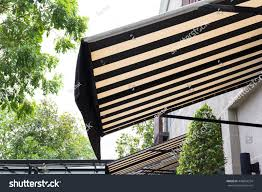 Black White Awning Decor Front Shop Stock Photo 448853254 ... Metal Front Porch Awnings Door Wooden Awning Wood For Home Pergola Design Fabulous Alinum Pergola With Retractable Canopy Pop Up Uk Gazebo White Carrying Bag White Pella Windows With Awning Matched Faux Brick Wall For Decor Exterior Design Sensational Wall X Tent W 4 Removable Window Side Vintage Trailer From Oldtrailercom 72018 Sunbrella Shade Collection Beneficial Patio Your Perfect Day Patio Closeup Of Bluewhite Striped Above Blue Front Door In Guard Protect Your Rv The Sun And Weather