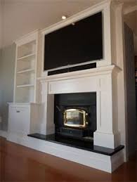 where to put cable box with tv over fireplace