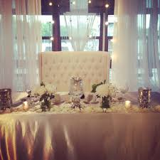 Head table settee couch mercury glass vases white bouquets