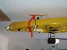 Kayak Hoist Ceiling Rack by Garage Kayak Pulley System Kayak Hoists And Effect On Boat