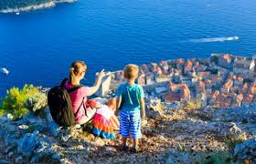 Mother With Kids Looking At Scenic View In Dubrovnik Croatia