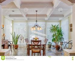 Vaulted Ceilings In Luxury Yellow Dining Room