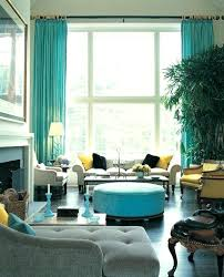 Turquoise Kitchen Island Living Room With Round Blue Ottoman Coffee Table And Curtains Plus White Fireplace