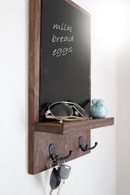 Appealing Chalkboard Key Holder Colored In Black And Designed Simple Style Combined With Wooden Frame Placed On White Painted Wall