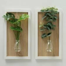 deko wandbehänge aus holz mit natur thema fürs wohnzimmer