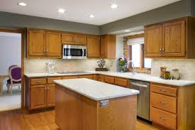 Kitchen Backsplash With Oak Cabinets by Decorating Granite Countertop On Kitchen Island And Oak Cabinets