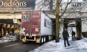 100 Brown Line Trucking Truck Meets Bridge The Story Behind Spokanes Muchscarred