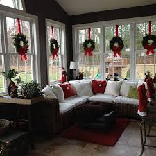 Love The Wreaths Suspended With Red Ribbon In Windows Of This Sunroom Decorated For DecoratingSunroom IdeasPorch
