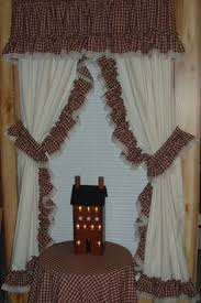 Primitive Curtains For Living Room by Love How Tina Took A Candle Ring And Used It For A Tie Back To Her