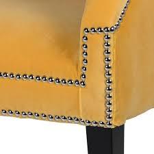 senfgelbe sitzbank mit chromnieten und schwarzen holzfüßen samt sofa gelb