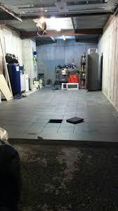 Racedeck Flooring Vs Epoxy by Garage Floor Coating Epoxy Vs Industrial Porcelain Tiles