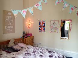 Remarkable Student Bedroom Design Ideas With Floral Pattern Bedding Sets And Unique Fairy Light Also Rectangle Frame Wall Mirror Feat Hanging Triangle Flag