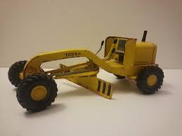 Vintage Toys: 1964 Mini-Tonka Grader (Photo) | Charlie R. Claywell 4runner Tonka Trucks Stretch Tundras And Soedup Vans Surprise Blind Boxes Mini Trucks Youtube Tinys Complete Collection By Funrise Hasbro Antiques Art Vintage Truck Crane 1902547977 Cheap Trophy Find Deals On Line At 197039s Toys A Scraper In Yellow Dump Jumbo Foil Balloon Walmartcom 1970s 5 Pressed Steel Lot Set Of 9 Diecast Review Wagoneer With Snowmobile Trailer 1081
