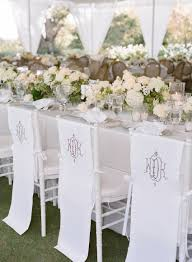White Monogram Chair Covers On Chairs
