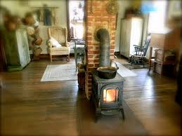 Wood Burning Stove Chimney In The Middle Of A Room With Wooden Floor