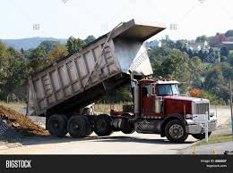 Peterbilt Dump Truck Image & Photo (Free Trial) | Bigstock Peterbilt Triaxle Dump Truck Chris Flickr 2017 567 500hp 18spd Eaton Trucks Pinterest Pin By Us Trailer On Custom 18 Wheelers And Big Rigs 2004 330 For Sale 37432 Miles Pacific Wa Paris Star On Classifieds Automotive 2005 End Kirks Stuff Filewsor Truckjpg Wikimedia Commons Dump Truck Camions Exllence Dump Truck Models Toys Games Compare Prices At Nextag Custom 379 Tri Axle Wheels A Dozen Roses Orange Peterbilt Promotex 187 Ho Scale Maulsworld Used Chevy Fresh 335