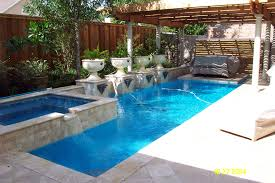 Awesome Small Swimming Pools Designs To Refresh Backyard Area ... Outdoor Pool Designs That You Would Wish They Were Yours Small Ideas To Turn Your Backyard Into Relaxing With Picture Pools Fiberglass Swimming Poolstrendy Rectangular Home Decor Stunning Mini For Yard Very Small Backyard Pool Sun Deck Grotto Slide Charming Inground Backyards Images Inspiration Building Design And Also A Home Decoration For It Is Possible To Build A Awesome Refresh Area Landscaping Decorating And Outstanding Adorable