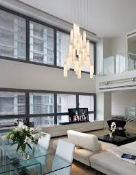 white candles chandelier by galilee lighting two story living