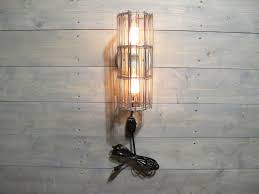 rustic wall sconce w cord and grey galvanized steel cage