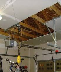 Hanging Drywall On Ceiling Trusses by How To Install Kraft Faced Fiberglass Insulation In A Garage