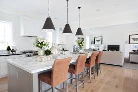 gray kitchen island with four stools transitional kitchen