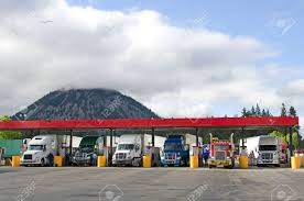 Several Large Over The Road Semi-trucks Fuel Up At A Fueling.. Stock ... Big Rig Trucks In Parked At Truck Stop Mojave California Stock Lined Up At Truck Stop In Central Photo Stops I Love Em Our Great American Adventure San Diego 2506 Watching Trucks The Loves Youtube A Loves Ripon 23467653 Alamy Stops New Branding And Amenities They Offer Westnorth Two Mile Ca Fe By Wojczuk Michael Crosscut Saw Unltd Redding Travel Center Sign Grapevine On Little Caesars Hiway 80 Longview Local News Carls Jr Restaurant Santa Nella A